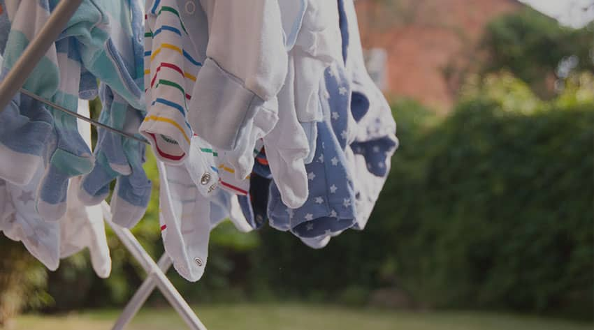 baby clothes on a drying line in the garden