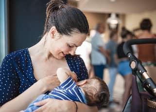 Mother breastfeeding in public